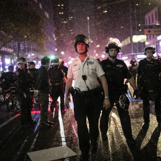 Police advance to arrest protesters breaking curfew
